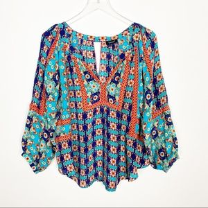 {Anthro} Tolani silk floral peasant top